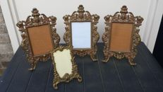 Four metal standing photo frames, second half of 20th century
