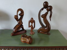3 wooden statues in a wooden box shaped like a peanut - Bali - Indonesia