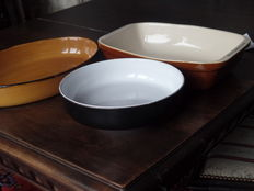 Two fire-proof glazed bowls and one large fruit - or vegetable bowl.