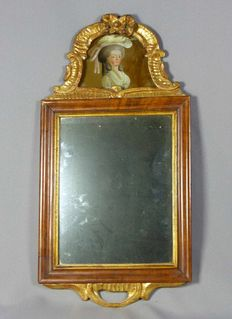 A Louis XVI carved and gilt-wood mirror with the portrait of Queen Marie Antoinette, painting on glass - France - circa 1800 and later