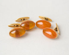 Two pairs of Baltic Amber cuff links, orange, butterscotch, egg yolk amber colour