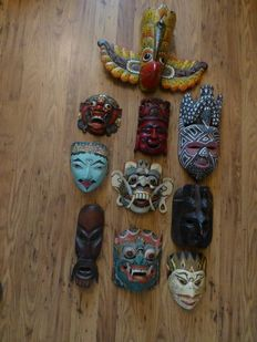 Ten wooden masks - Indonesia and Sri Lanka.