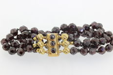 Garnet bracelet with a gold clasp