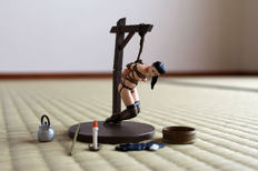 Figurine; Ero-Pon Series: Woman in bondage, hanging on a pole - 21st century