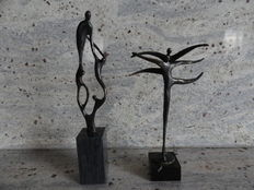 2 signed bronzed sculptures, on stone pedestals, Corry Ammerlaan van Niekerk