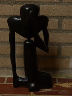 Black ebony Makonde sculpture from Tanzania depicting a Thinker
