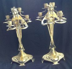 A pair of reproduced and unique silver plated candelabra in the Art Nouveau style