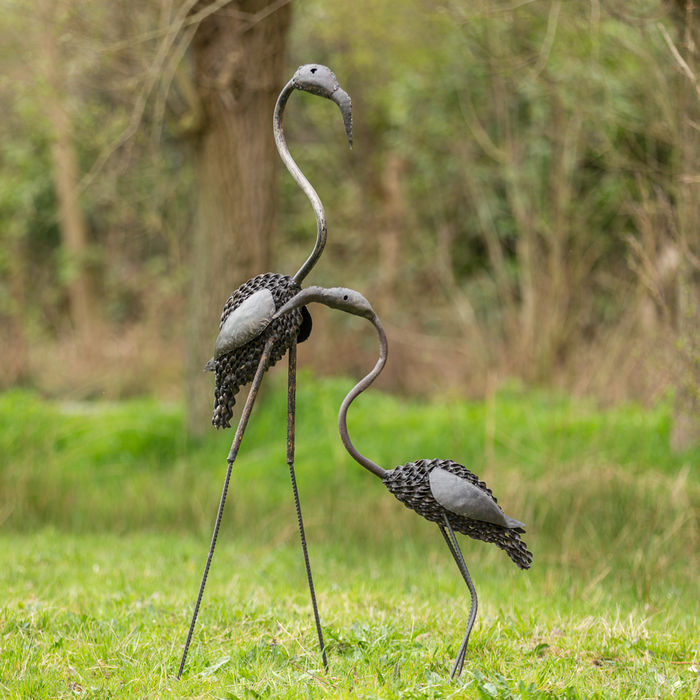 Two flamingo sculptures of metal