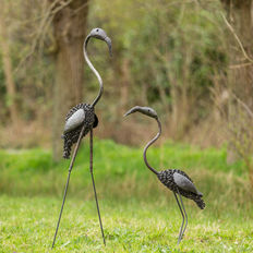 Two flamingo sculptures