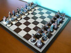 "Resin chess: ""7th Cavalry vs the Apaches"". Wooden chessboard"