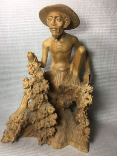 Wooden statue of a fisherman - Bali - Indonesia