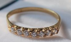 Yellow gold row ring of 14 kt, with zirconias - ring size: 17.5