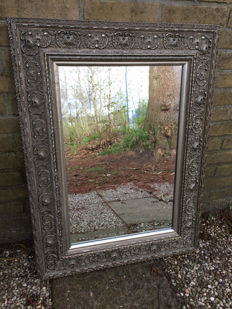 Mirror with cut glass in floral frame
