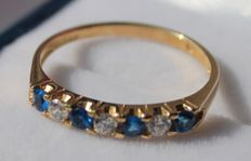 Gold ring, 14 kt, inlaid with sapphire and zirconia, ring size 16.75.