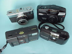 Four Olympus rangefinder cameras: the Superzoom 700XB, the Mju I, the Trip 35 and the AF-1