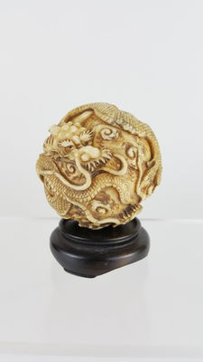 Carved Ivory dragon ball - Japan - late 19th century