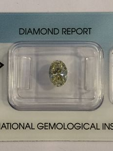 1.03ct, ovaal, Natural Fancy Light Brownish Yellow