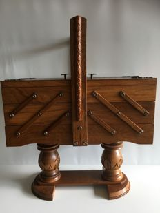 Hand-carved oak foldable trapeze model sewing box from 1920