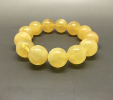 Bracelet of Baltic amber beads ø15.5 mm, weight 27 grams, yellow colour