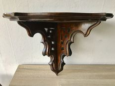 Large antique hand carved walnut wall bracket.