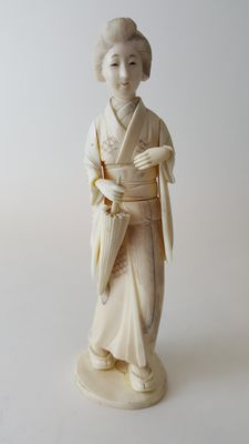 Ivory Okimono of a lady - Japan - late 19th century