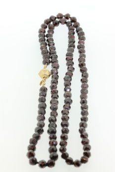 Garnet necklace with antique gold clasp.