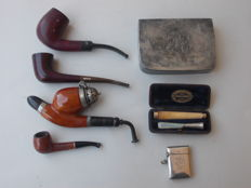 4x pipes, 2x mouthpieces, 1x black silver plated pipe tobacco box with engraved initials, 1x silver plated hallmarked matchbox with engraved initials - early 20th century