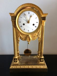 A fine French Empire gilt bronze portico mantel clock - ca 1810