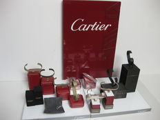 Cartier display set with Cartier branded display plaque (brand in white). Two bases and various display mounts  for watches of differing heights (at least 15 in total in various finishes).