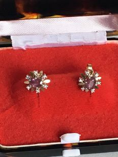 Earrings with  oval ruby   aproxx 1 ct  and 6 -diamonds