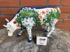 Two CowParade composite coloured cows with matching boxes