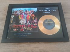 """The Beatles """" Sgt pepper's """" framed gold CD and signatures ( pre-printed)."""