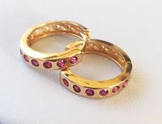 Yellow gold creole earrings with pink-red zirconias - countenance size earrings 19 x 3 mm - size earring Ø 16 mm.