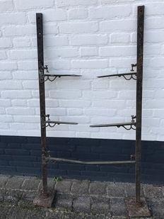 Two sturdy iron shelf brackets