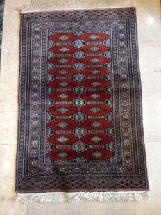 Pair of Bookara carpets from Pakistan