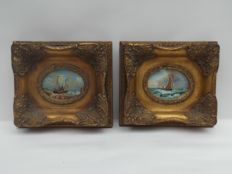 Unknown artist - two oval paintings with ships in carved wooden picture frame