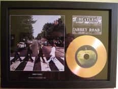 The Beatles, signed( printed facsimile signatures )framed photo and gold record effect CD disc presentation.for their Album; 'Abbey Road'. Apple Record label.