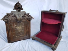 Portable tabernacle carved in dark wood, with red fabric lining