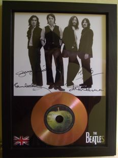 The Beatles, signed( printed facsimile signatures )framed photo and gold record effect CD disc presentation.for their song; 'Hey Jude'. Apple Record label.