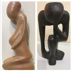 2 African artistic sculptures, 1 pregnancy stone and 1 ebony thinker.