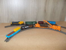 "Mehano H0 – diesel locomotive SD50 + crane carriage set ""CSX 7000"" and 5 loaded carriages of the Santa Fe"