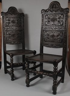 An interesting pair of Scottish carved oak hall chairs - late 19th century