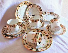 Four trios coffee and dessert Victoria C & E England with spectacular gilding.