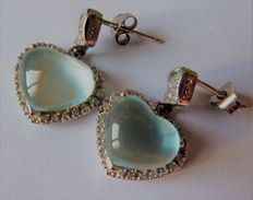Pair of hallmarked 18 kt gold earrings set with diamonds and topaz.