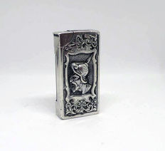 Solid silver wrought petrol lighter, repoussé and chiselled by hand - c.1920-30