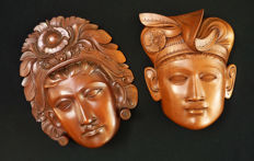 Woodcarved masks man and woman - Bali - Indonesia