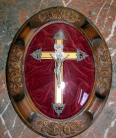 Antique crucifix in oval frame under convex glass, late 19th century, Lodeve, France