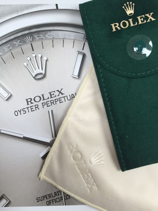 Original Rolex storage pouch and Rolex cleaning cloth