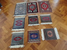 A lot of nine handknotted rugs.