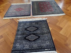 Three Persian carpets